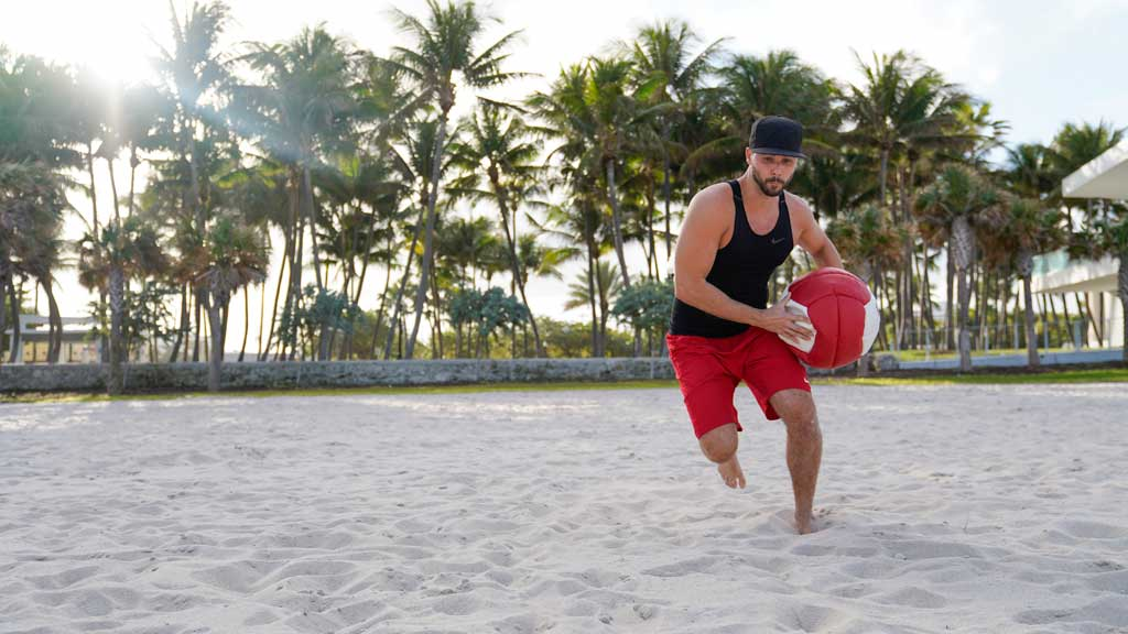 use the medicine ball at the beach to train strength and mobility